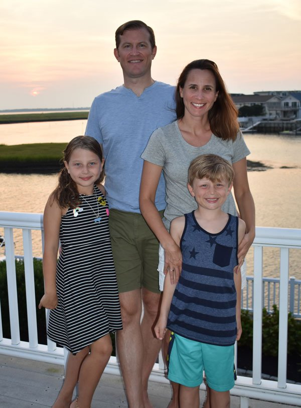 Portrait of Sacha Connor with her family at sunset